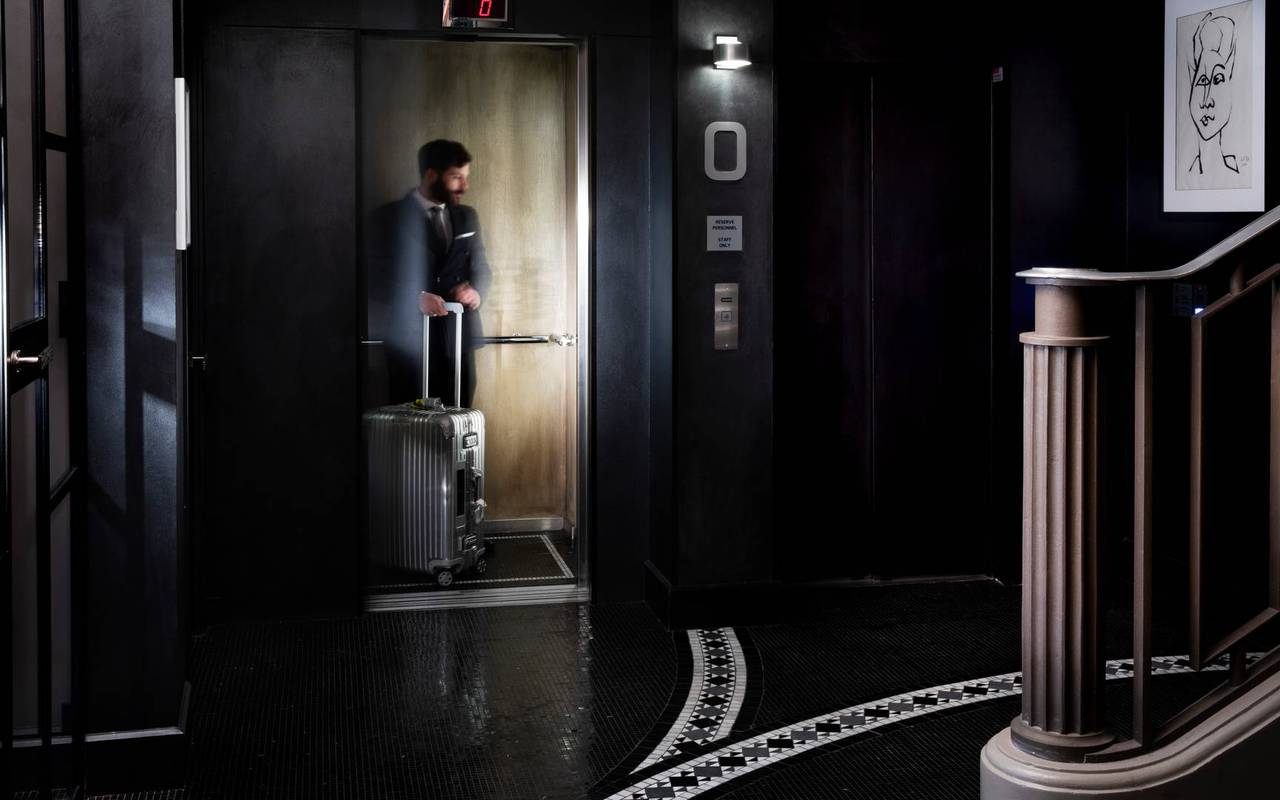 Entrance of the hotel with an elevator, hotel in Paris France Eiffel Tower, Juliana Hotel Paris